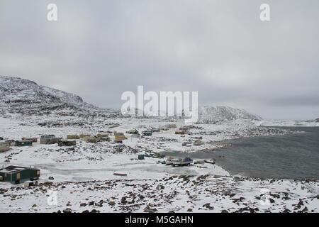 View of Cape Dorset (Kinngait) Nunavut with a view of the mountains and ocean, a northern Inuit community in arctic - Stock Photo