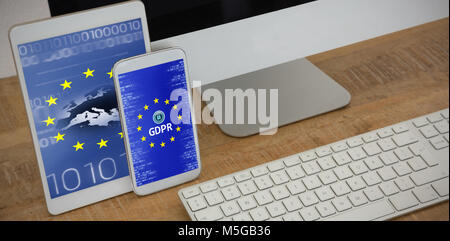 Composite image of various electronic gadgets on table - Stock Photo