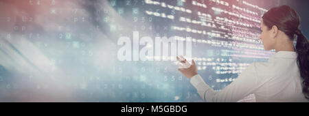 Composite image of female executive pressing an invisible virtual screen - Stock Photo