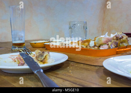 Leftover food on place after partying - Stock Photo