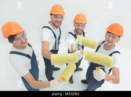 view from the top.a group of decorators with a paint roller - Stock Photo