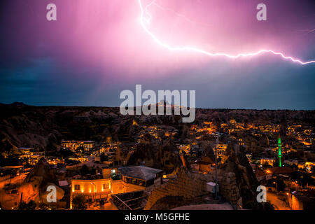 Lightning above the town of Goreme in Cappadocia in Turkey. Dramatic night sky, storm. - Stock Photo