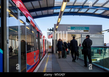 London Docklands Light Railway: Passengers disembarking at London City Airport station. - Stock Photo