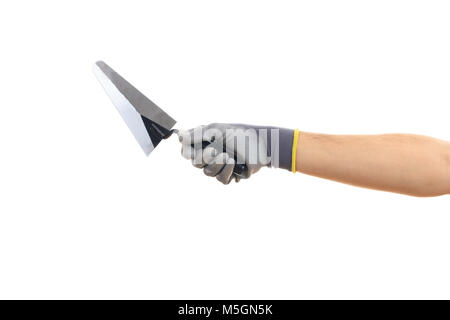 Hand holding a metal spatula on white background - Stock Photo