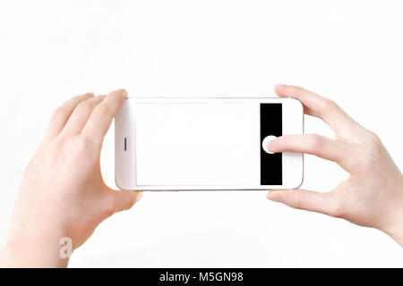 Mock-up of making photo on a smartphone - Mock-up of making photo on a smartphone - woman's hands holding mobile - Stock Photo