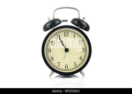 Classical retro alarm clock isolated on a white background in close-up - Stock Photo