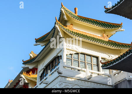 View of the chinese-inspired architecture of the Huatian Chinagora hotel complex with curved roof corners and traditional - Stock Photo