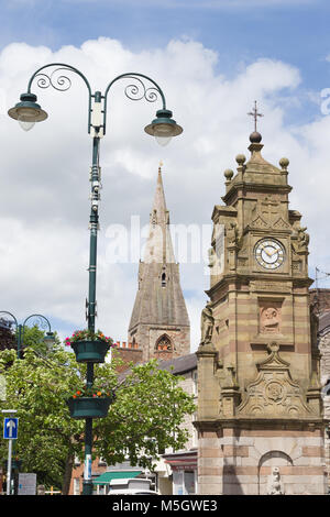 Saint Peters Square in Ruthin with it's historic buildings including the Peers Memorial clock tower and the Spire - Stock Photo