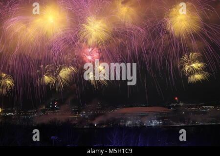 Moscow, Russia. 23rd Feb, 2018. Fireworks light up the sky over Luzhniki Stadium during celebrations marking Defender - Stock Photo