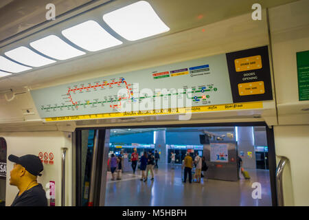 SINGAPORE, SINGAPORE - JANUARY 30, 2018: Indoor view of informative sign of train stops view from inside of Mass - Stock Photo