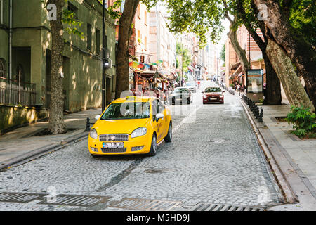 Istanbul, June 15, 2017: A traditional yellow taxi rides on the street. Turkey. Urban life style. Transportation - Stock Photo