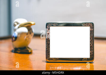 Miniature Silver Photo Frame Mock up with ceramic figure - Stock Photo