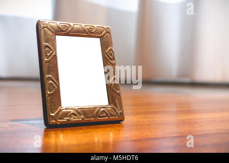 Miniature Silver Photo Frame Mock up on wooden parquet - Stock Photo