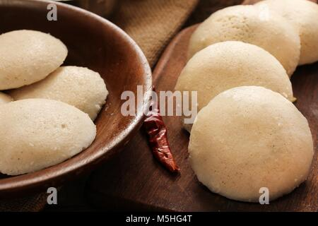 Idli with sambar chutney - South Indian breakfast made of lentil and rice - Stock Photo