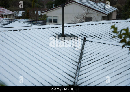 Snow Covered House Roof - Stock Photo