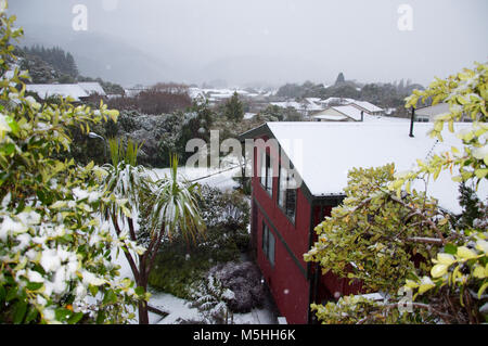 Snow Covered House Roof Tops - Stock Photo