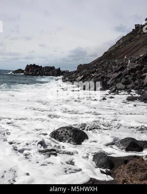 Salinas de Fuencaliente, La Palma. Canary Islands Spain.  Lots of sea foam is created by the sea water rushing through - Stock Photo