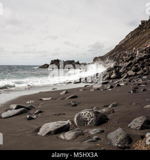 Salinas de Fuencaliente, La Palma. Canary Islands Spain.  Waves crashing on to the lava beach.  Some large lava - Stock Photo
