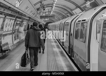 London, United Kingdom, February 17, 2018: London Underground station with people leaving train and moving out of - Stock Photo