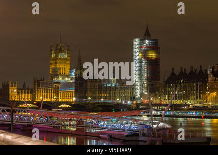 London, United Kingdom, February 17, 2018: Westminster bridge and big ben renovation scaffolding construction with - Stock Photo