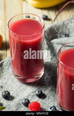 Raw Organic Red Berry Juice Smoothie in a Glass - Stock Photo