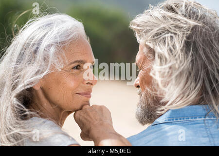 Beautiful senior woman smiling at her husband - Stock Photo