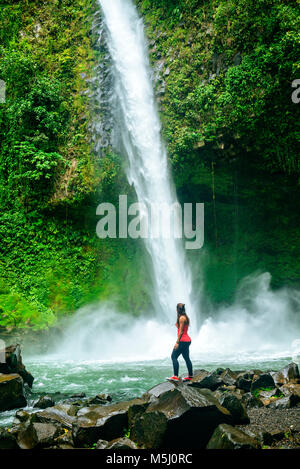 Costa Rica, Arenal Volcano National Park, Woman at the waterfall of La Fortuna - Stock Photo