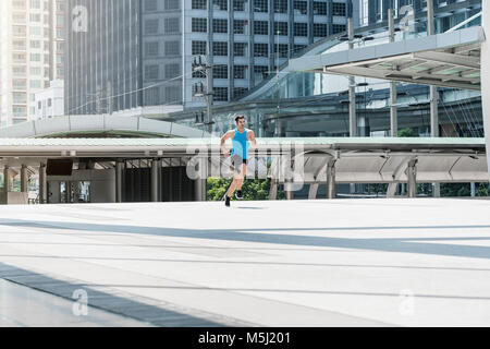 Fit man running in the city - Stock Photo