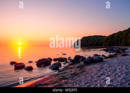 Germany, Mecklenburg-Western Pomerania, Baltic sea seaside resort Binz, beach at sunset - Stock Photo