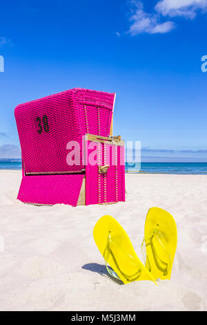 Germany, Mecklenburg-Western Pomerania, Baltic sea seaside resort Binz, Hooded beach chair on the beach - Stock Photo