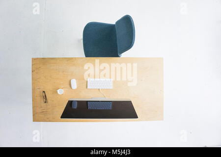 Desk in office seen from above - Stock Photo