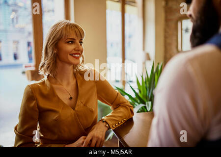 Elegant smiling woman with man in a bar - Stock Photo