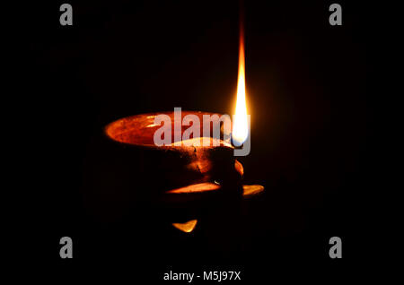 Diya for Diwali. clay lamp, typically used in Hindu temples in India and Nepal for worship. - Stock Photo