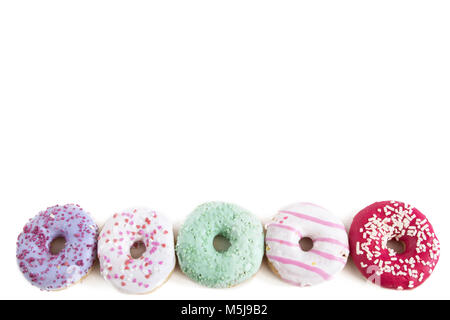 Donuts isolated on white background. Top view. - Stock Photo