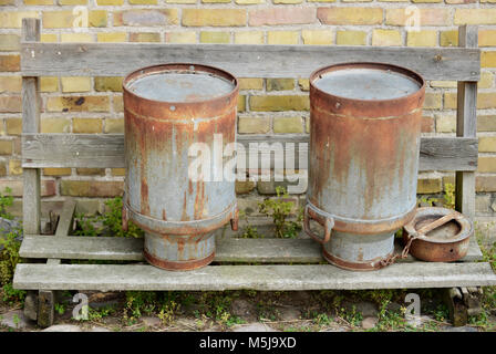 Old fashioned milk cans of the past - Stock Photo