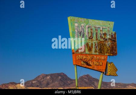 Abandoned Vintage Rusty Sign In Arizona Desert - Stock Photo