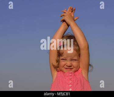 Happy, funny little girl on sea, selective focus.