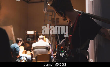 Film set - sound engineer working on the independent cinema production - Stock Photo