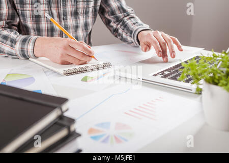 Stock market chart and finger pointing   - Stock Photo