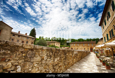 Old thermal baths in the medieval village Bagno Vignoni, Tuscany, Italy/  Spa basin in the antique italian town - Stock Photo