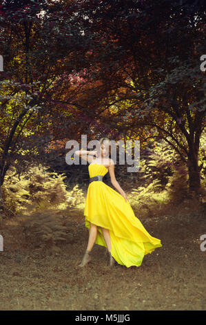 Photo of young beautiful lady in fairy forest - Stock Photo