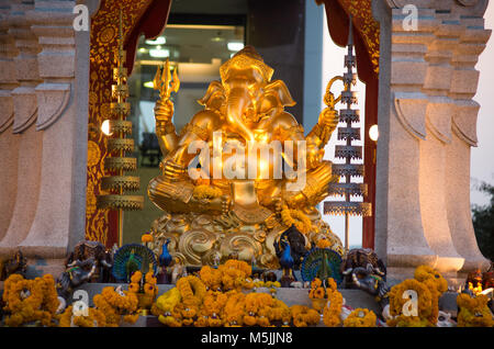 BANGKOK, THAILAND, MARCH 01, 2017 - Golden Ganesha god statue in front of the Central World Plaza. The elephant - Stock Photo