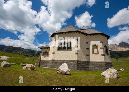 Beautiful mountain church under a sunny blue sky with clouds/Trentino/Dolomites/Italy - Stock Photo