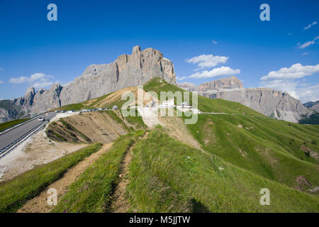 The Sella group near the Passo Sella in Val Gardena and Sass Pordoi with flowering meadows and mountain hiking trails/ - Stock Photo