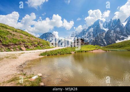 Dolomites Alps in Italy, Pale di San Martino mountains and Baita Segantini with the lake / landscape - Stock Photo
