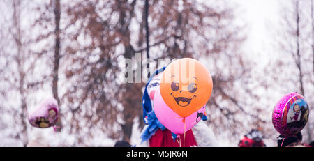 balloon smiling emotions at the festival, on the street - Stock Photo