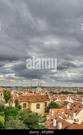 A view of Prague's old town from Petrin Hill as storm clouds gather over the historic Eastern European city. Stock Photo