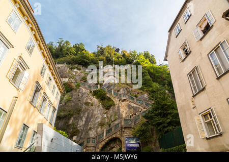 GRAZ, AUSTRIA - SEPTEMBER 16, 2016 : Medieval clock tower Uhrtrum in Schlossberg Castle public park around hill, - Stock Photo
