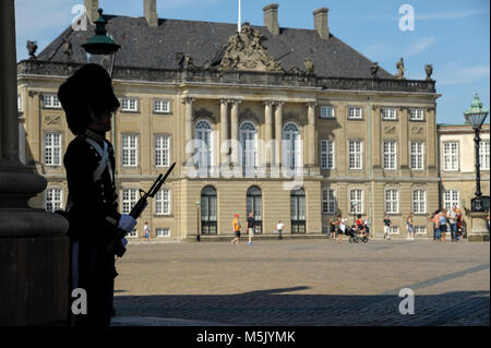 Royal Life Guard (Den Kongelige Livgarde) in front of Rococo Christian VIII's Palae or Levetzaus Palae (Christian - Stock Photo
