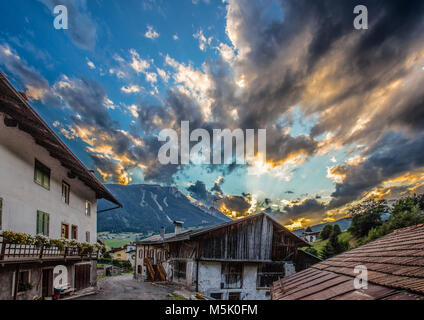 Summer view of a center road of the city of Moena,Trento, at sunset, in the Dolomites, Trentino, Italy - Stock Photo